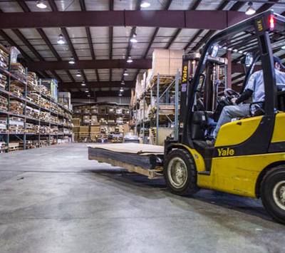 Plastic material handling via tow motor at HP Manufacturing's distribution warehouse
